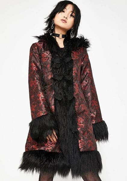 A sweet synthetic long red coat with dragons on it and a black fur trim.